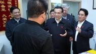 Als Helfer noch willkommen waren: staatlicher Besuch bei einer Hilfsorganisation für HIV-Infizierte in Peking
