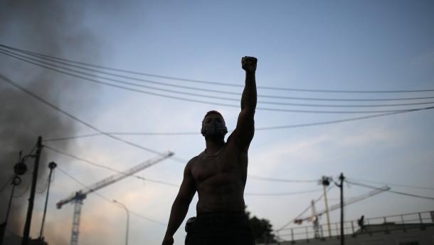 Menschen protestieren gegen Rassismus und Polizeigewalt