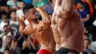 Die wohlgeformten Bodybuilding-Körper sollen auch schön braun sein (Archivaufnahme)