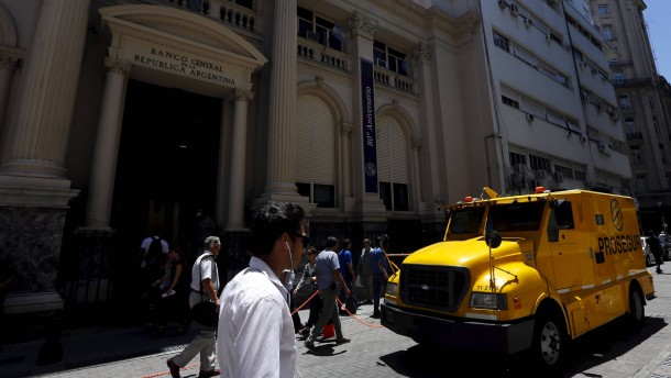 An armored bank trucks passes by Argentina's Central Bank in Buenos Aires' financial district