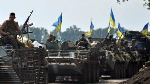 Merkel und Putin wollen über Ostukraine sprechen