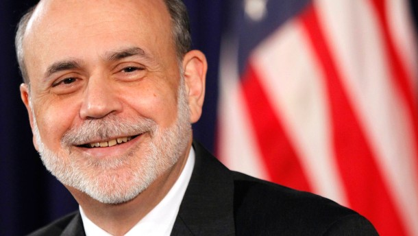 U.S. Federal Reserve Chairman Ben Bernanke smiles during a news conference in Washington