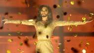 Conchita Wurst - eine professionell auftretende Künstlerin, die eigentlich ein Mann ist, der Thomas Neuwirth heißt.