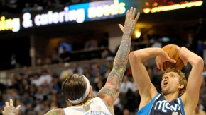 Dallas Mavericks Dirk Nowitzki gets a shot over Denver Nuggets Chris Andersen in Denver, Colorado