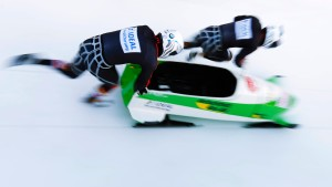 Germany's pilot Friedrich and brakeman Baecker start the third run of the 2-men competition at the FIBT Bobsleigh and Skeleton World Championships 2013 in St. Moritz