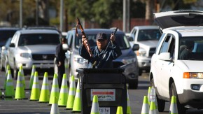 Police officers collect guns from people in their cars at a gun buyback held by the LAPD in Los Angeles