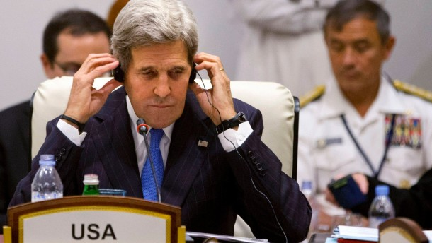"U.S. Secretary of State Kerry listens to a translation during the London 11 countries ""Friends of Syria"" meeting in Doha"