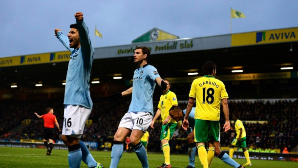 Manchester City's Dzeko celebrates scoring a goal against Norwich City during their English Premier League soccer match in Norwich
