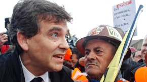 File photo of France's Minister for Industrial Recovery Montebourg talking to ArcelorMittal workers from Florange after a meeting with trade union representatives in Florange
