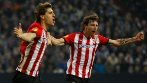 Athletic Bilbao's Llorente and Amorebieta celebrate a goal against Schalke 04 during the Europa League quarter-final match in Gelsenkirchen