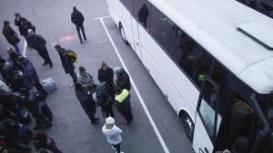 Im Bus mit Wanderarbeitern