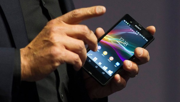 Molyneux of Sony Electronics Inc. holds a Sony Xperia Z smart phone during a Sony news conference at the CES in Las Vegas
