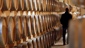 Barrels of wine are stored in the cellar of Chateau Larose Trintaudon in Saint Laurent Medoc, near Bordeaux