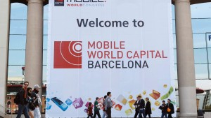 People walk by main entrance of the Mobile World Congress in Barcelona