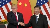Da war von einem Handelskrieg noch keine Rede: Donald Trump und Xi Jinping bei einem Treffen in Peking vergangenen November.