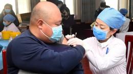 China führt Corona-Impfausweis für Reisende ein