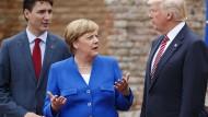 Zwei Pole der Außenpolitik: Merkel zwischen Kanadas Premier Trudeau und dem amerikanischen Präsident Trump