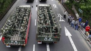 China richtet acht Verdächtige hin