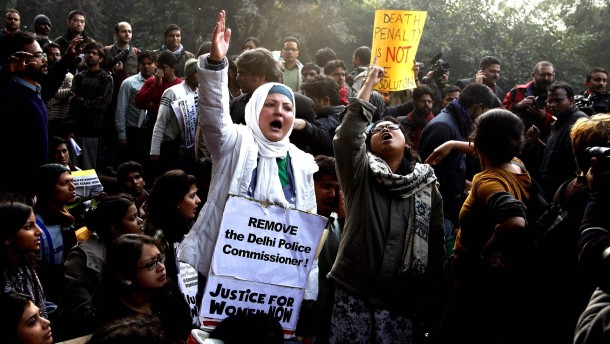 Indian students and activists shout slogans and hold placards as