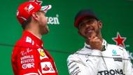 Respektieren sich gegenseitig: Lewis Hamilton (r.) und Sebastian Vettel loben sich jeweils in höchsten Tönen