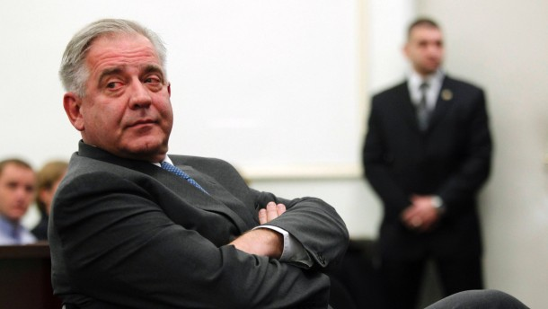 Former Croatian Prime Minister Ivo Sanader sits at a county court in Zagreb