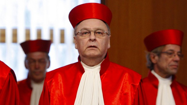 President of the German Constitutional Court Papier arrives for the pronouncement of a judgement about telecommunications data retention in Karlsruhe