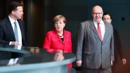 Merkel und ihr Vertrauter: Kanzleramtsminister Altmaier (rechts)