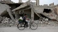 Zerstörte Häuser in einem Vorort von Damaskus