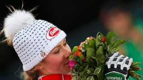 First placed Mikaela Shiffrin of the U.S. smells her bouquet of flowers on the podium during the flower ceremony of the women's Slalom race at the World Alpine Skiing Championships in Schladming