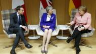 Emmanuel Macron, Theresa May und Angela Merkel (rechts) im März beim EU-Gipfel in Brüssel