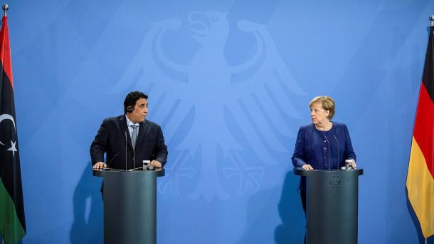 Merkel pocht auf Dezember-Wahlen in Libyen