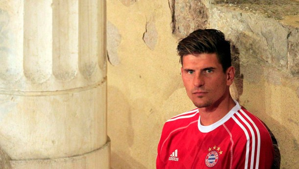 Bayern Munich's Mario Gomez looks on as he waits for a presentation in Riva del Garda