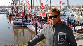 England's skipper Thomson poses in front of the fleet of the Vendee Globe Challenge sailing race at Les Sables d'Olonne, on France's Atlantic coast