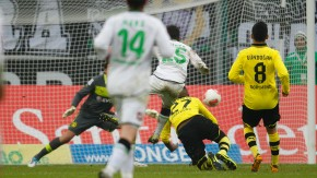 Borussia Moenchengladbach's Younes scores a goal against Borussia Dortmund during the German first division Bundesliga soccer match in Moenchengladbach