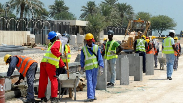 Foreign laborers work Doha