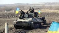 Putin und Poroschenko wollen schnellen Waffenabzug