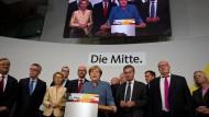 Viele Stimmen verloren, die Macht erhalten: Angela Merkel