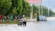 In der chinesischen Provinz Fujian wütete der Tropensturm besonders heftig. In der Stadt Putian kam es zu heftigen Überschwemmungen.