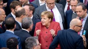 Bundestag stimmt UN-Migrationspakt zu