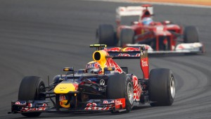 Red Bull Formula One driver Webber drives ahead of Ferrari's Alonso during the Indian F1 Grand Prix at the Buddh International Circuit in Greater Noida