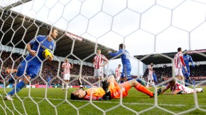 Chelsea's Lampard collects the ball after an own goal from Stoke City's Walters during their English Premier League soccer match in Stoke-on-Trent