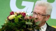 Hinter der Blume: der baden-württembergische Ministerpräsident Winfried Kretschmann