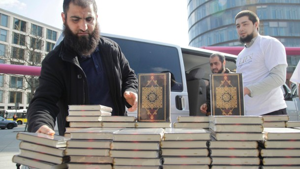 Supporters of ultra-conservative Salafist Muslim group set up stand handing out German-language versions of the Koran in Berlin
