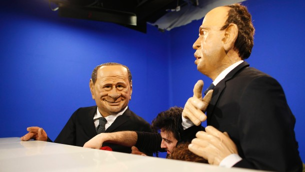 Italian actors operate the puppet of Italy's former Prime Minister Berlusconi and People of Freedom Party (PDL) secretary Alfano during the filming of a television show in Rome