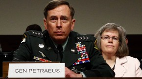 File photo of General Petraeus and his wife at a hearing in Washington