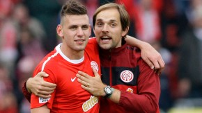 Mainz 05's Szalai and coach Tuchel celebrate their victory over TSG Hoffenheim's after their German Bundesliga soccer match in Mainz