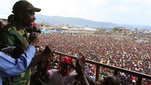 The M23 rebels spokesperson Kazarama speaks to crowd who have gathered at a stadium in Goma