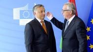 Der ungarische Ministerpräsident Viktor Orbán und EU-Kommissionschef Jean-Claude Juncker bei einem Treffen am Sonntag in Brüssel
