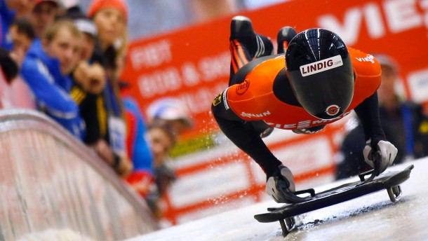 "Germany's Rommel jumps on his skeleton to take the third place in the men's skeleton test event at the ""Sanki"" sliding center in Rosa Khutor"