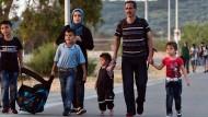 Nahles und Steinmeier fordern mehr Unterstützung für Flüchtlinge
